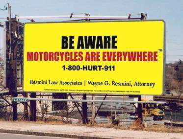 Large billboard by an attorney advertising motorcycle awareness