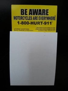 refrigerator magnet with notepad advertising motorcycle awareness and attorneys
